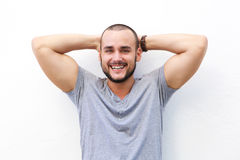 Handsome young man smiling with hands behind head Royalty Free Stock Photos