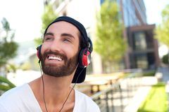 Handsome young man smiling with headphones Royalty Free Stock Image
