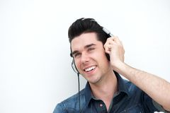 Handsome young man smiling with headphones Stock Photos