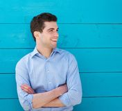 Handsome young man smiling outdoors Stock Image