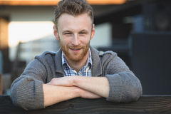 Handsome young man smiling outdoors Royalty Free Stock Photography