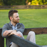 Handsome young man smiling outdoors Stock Photo