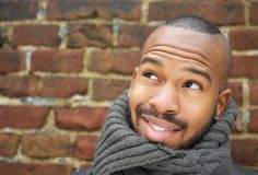 Handsome young man smiling with scarf outdoors Royalty Free Stock Image