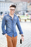 Handsome young man smiling on the street Stock Photos