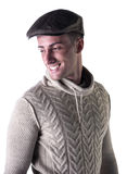 Handsome young man smiling, wearing knitted wool sweater and hat Royalty Free Stock Images