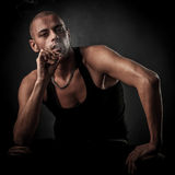 Handsome young man smokes cigarette in darkness - photography of Royalty Free Stock Images