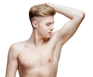 Handsome young man sniffing his armpit Stock Images