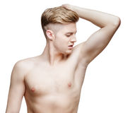 Handsome young man sniffing his armpit Royalty Free Stock Images