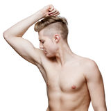 Handsome young man sniffing his armpit Stock Photography