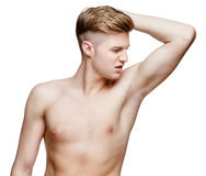 Handsome young man sniffing his armpit Royalty Free Stock Image