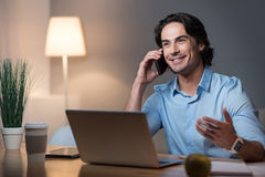 Handsome young man speaking on cellphone. Stock Photography