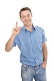 Handsome young man speaks up. Young man speaks up, finger point up - isolated on white royalty free stock image