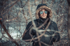 A handsome young man with spectacles in the Park. In winter Royalty Free Stock Photography