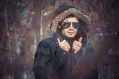 A handsome young man with spectacles in the Park. In winter Stock Photos