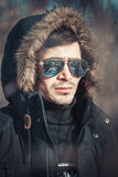 A handsome young man with spectacles in the Park. In winter Stock Photo