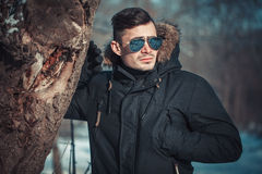 A handsome young man with spectacles in the Park. In winter Stock Images