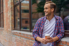 Handsome young man spending day in city stock images