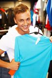 Handsome young man in a sport outlet Royalty Free Stock Image
