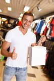 Handsome young man in a sport outlet Royalty Free Stock Photos