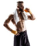 Handsome young man in sports wear wearing towel on his shoulders and drinks juice Stock Image