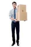 Handsome young man with with stack of boxes Royalty Free Stock Photos