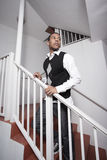 Handsome young man on a staircase Stock Image