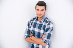 Handsome young man standing with arms folded Stock Image