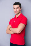 Handsome young man standing with arms folded Royalty Free Stock Photos