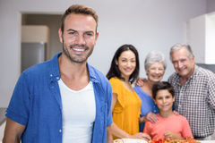 Handsome young man standing in kitchen Stock Images