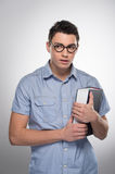 Handsome young man standing and looking. Royalty Free Stock Photography