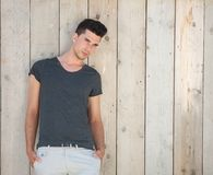 Handsome young man standing outdoors with hands in pocket Stock Photography