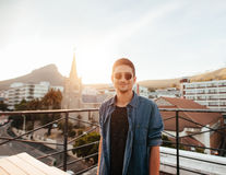 Handsome young man standing on the rooftop Royalty Free Stock Images