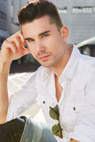 Handsome young man staring with hand to head Stock Image