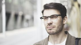 Handsome young man on the street thinking about future high tech project. Success and businesspeople concept Royalty Free Stock Images