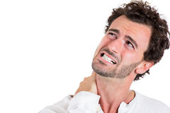 Handsome young man stressed and having a neck sprain Royalty Free Stock Photos