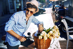 Handsome young man with a stylish bike Stock Photo