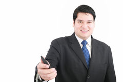 Handsome young man in a suit. Giving you a mobile Royalty Free Stock Photo
