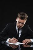 Handsome young man in suit on dark background Royalty Free Stock Photography