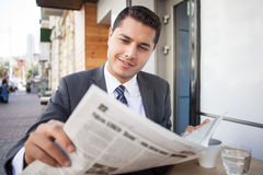 Handsome young man with suit is resting in cafe Royalty Free Stock Images