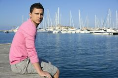 Handsome young man on summer in harbor Stock Photos