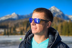 Handsome young man in sunglasse Stock Images