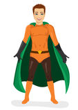 Handsome young man in superhero costume standing legs apart Stock Photography