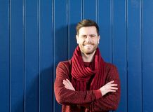 Handsome young man in sweater smiling outdoors Royalty Free Stock Images