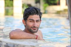 Young man in swimming pool. Handsome Young man in swimming pool Royalty Free Stock Photos
