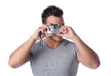 Handsome young man taking photo with compact camera Stock Photo