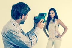Handsome young man taking photos of beautiful girl Royalty Free Stock Image