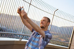 Handsome young man taking selfie camera with smartpone camera Royalty Free Stock Image