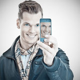Handsome young man taking a selfie Stock Photos