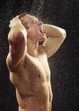 Handsome young man taking a shower Royalty Free Stock Photos