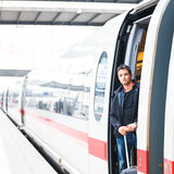 Handsome young man taking a train Stock Photography